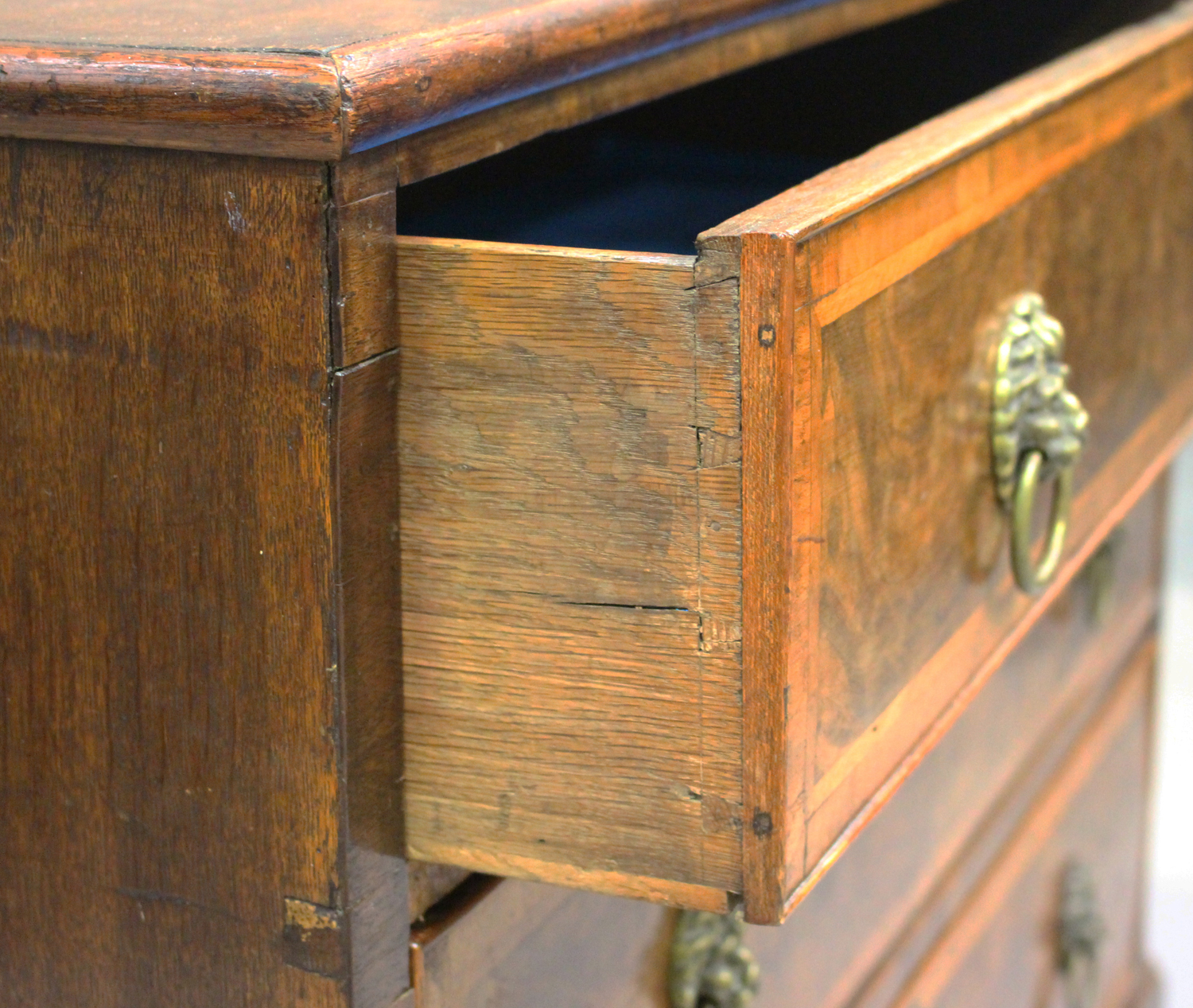 An 18th century oak and walnut chest of three drawers with crossbanded borders, on bracket feet, - Image 6 of 7
