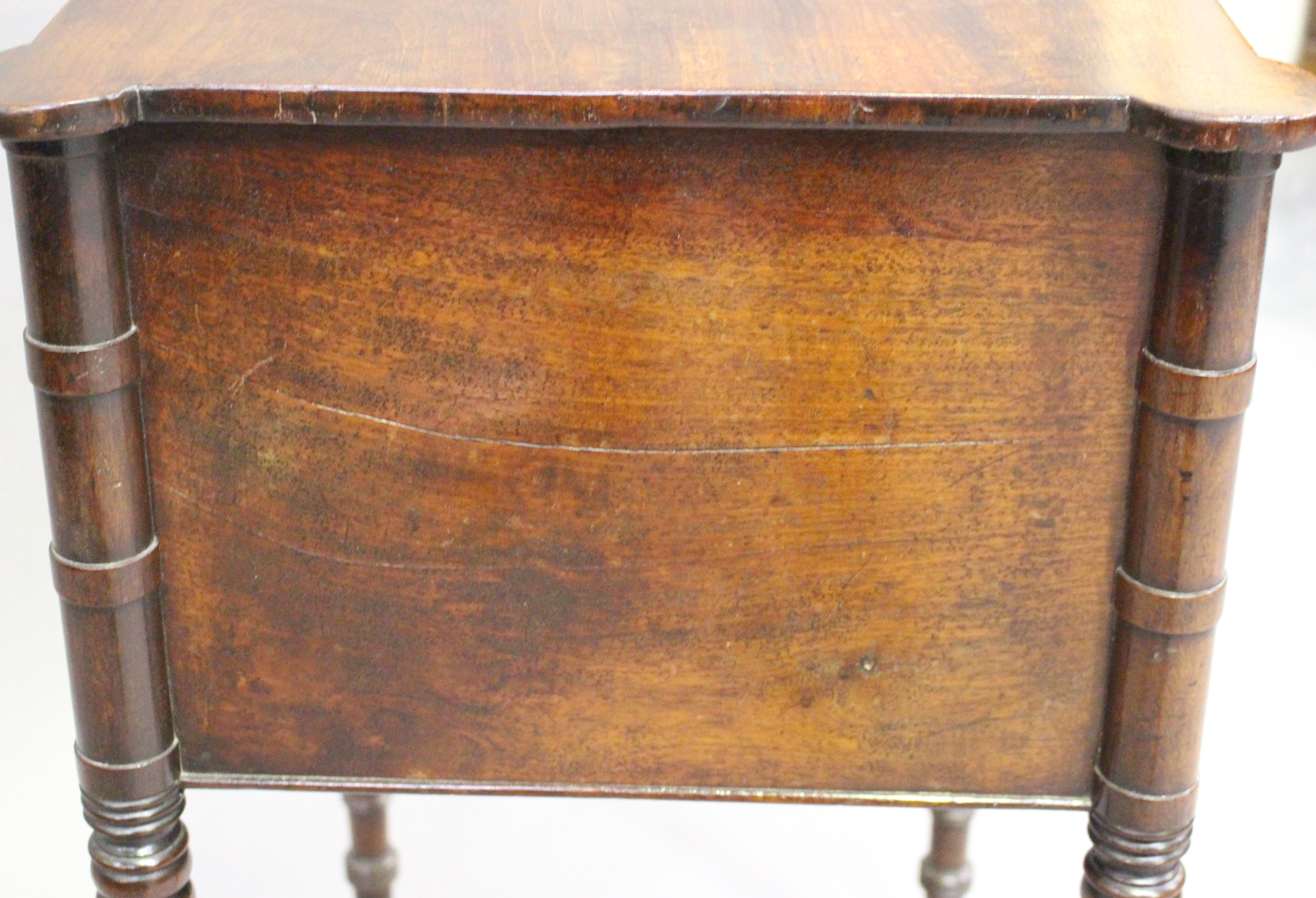 A George IV figured mahogany side table with projecting corners, the two drawers with bone handles - Image 5 of 8