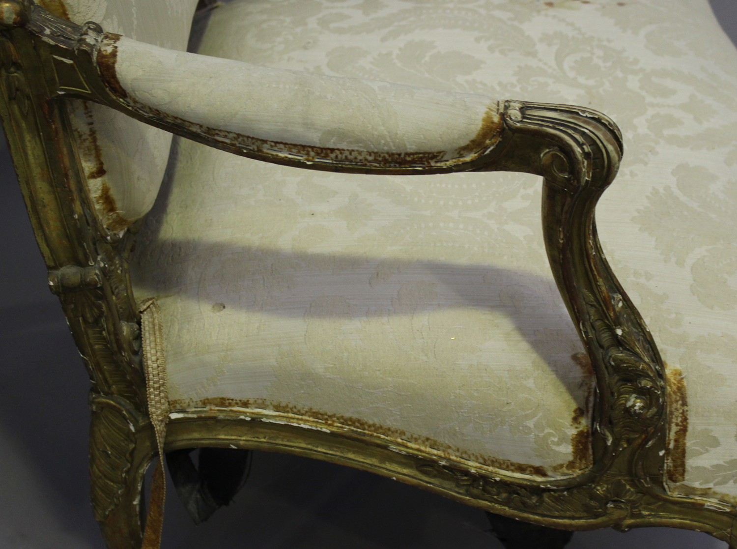 A 19th century French giltwood showframe fauteuil armchair with carved scroll decoration, on - Image 6 of 10