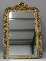 A mid-19th century carved giltwood and gesso framed pier mirror, profusely carved with leaf, fruit