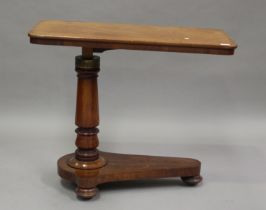 A late Victorian mahogany adjustable reading table, height 72cm, width 88cm, depth 45cm.Buyer's