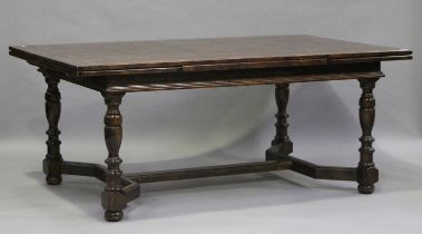 A 20th century oak draw-leaf dining table with parquetry top, on turned baluster legs, height