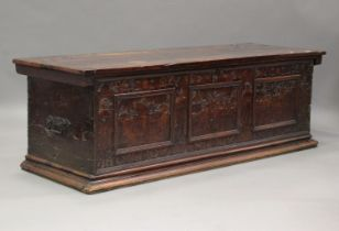A large 17th century Italian cedar and walnut Adige chest, the lid hinged to reveal poker and pen