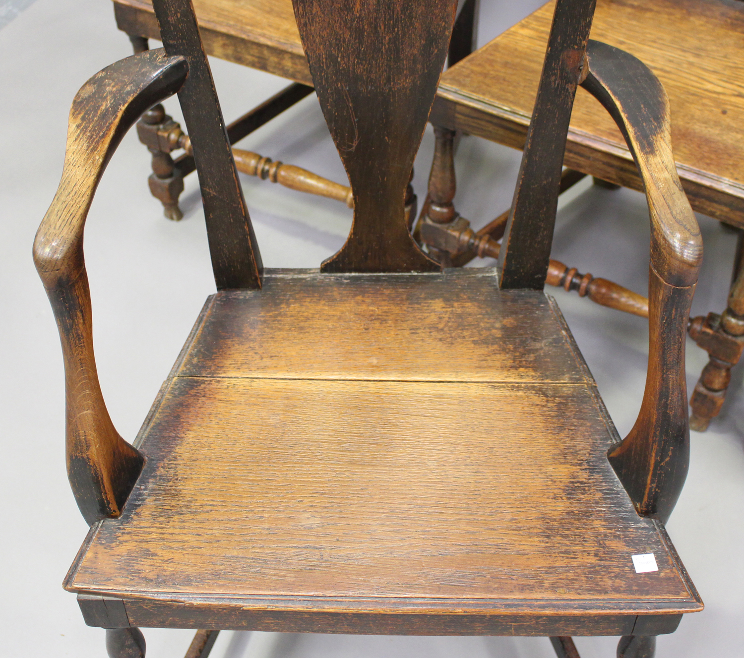 A set of four early 18th century provincial oak splat back dining chairs, the solid seats on - Image 2 of 5