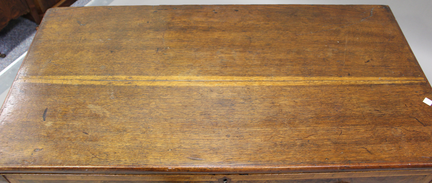 An 18th century oak and walnut chest of three drawers with crossbanded borders, on bracket feet, - Image 7 of 7