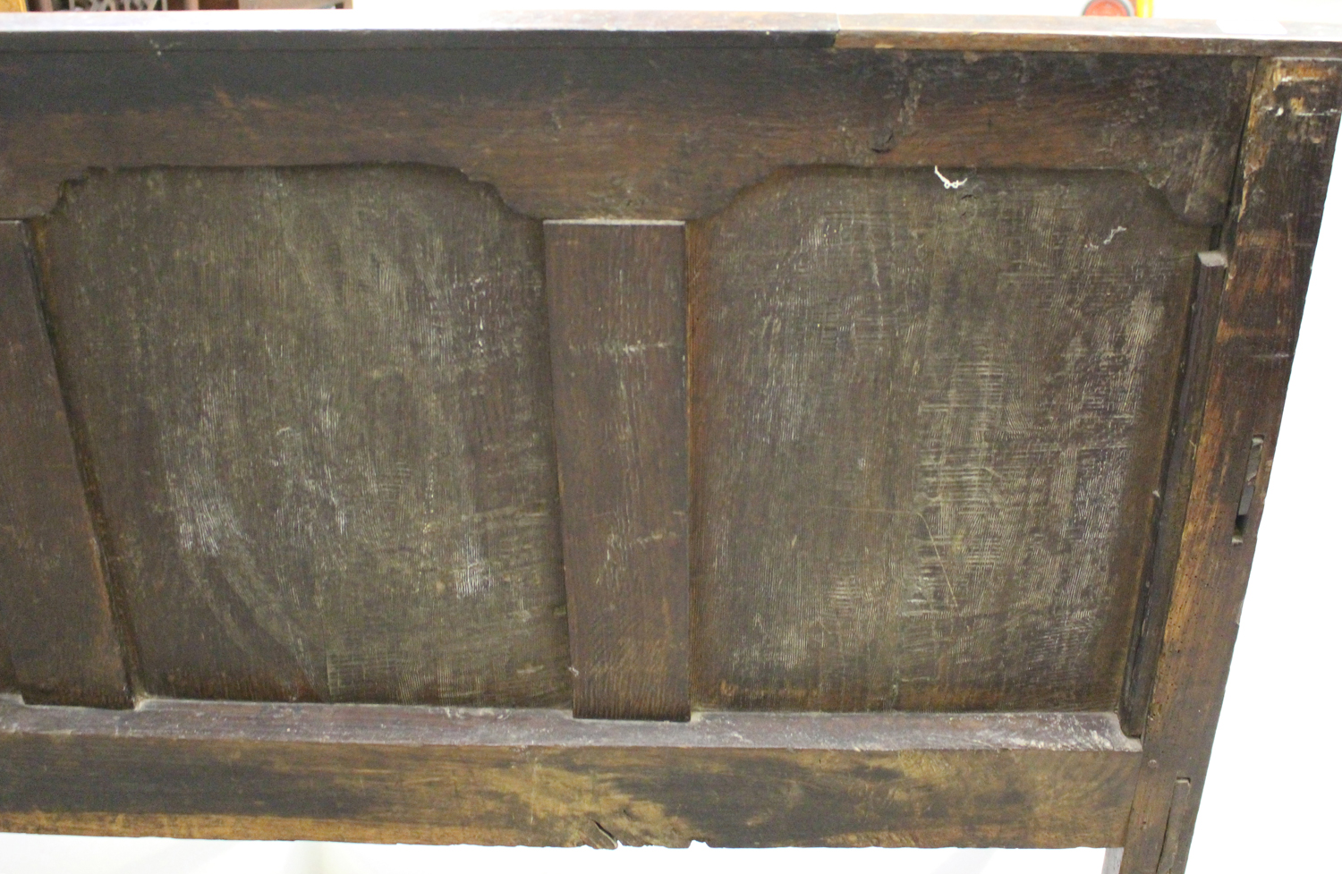A George III oak settle with four panel back, on turned legs and pad feet, height 102cm, length - Image 2 of 5