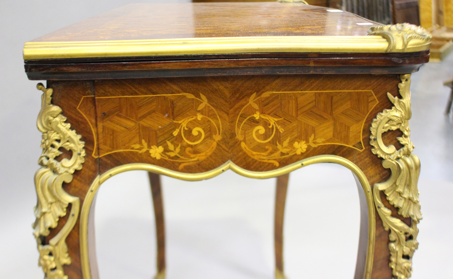 A late 19th century Louis XV style kingwood and parquetry veneered fold-over card table with gilt - Image 3 of 7