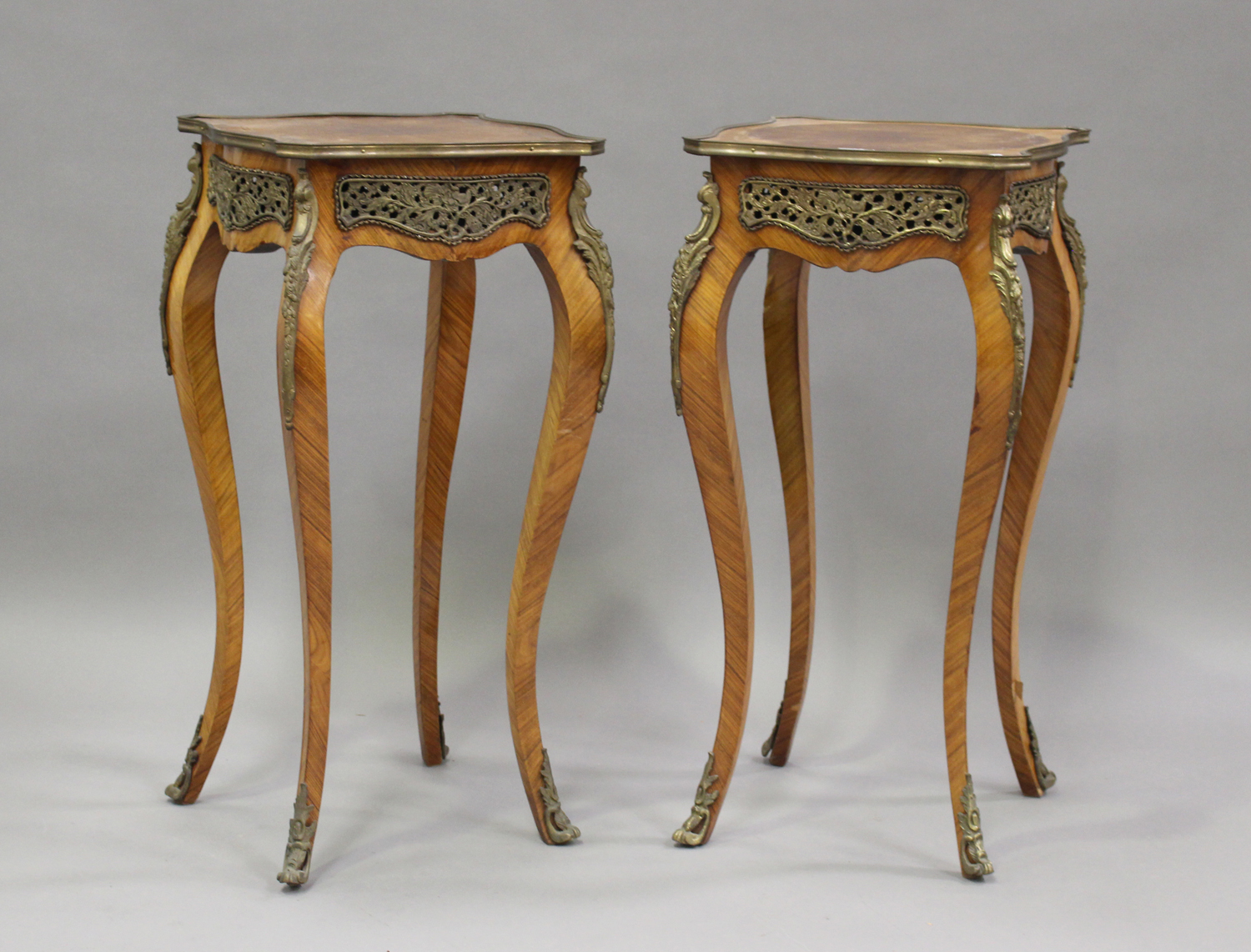 A pair of late 20th century Louis XV style kingwood and parquetry veneered jardinière stands with