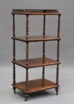 A Victorian mahogany four-tier whatnot with pierced gallery top, raised on bobbin turned supports,