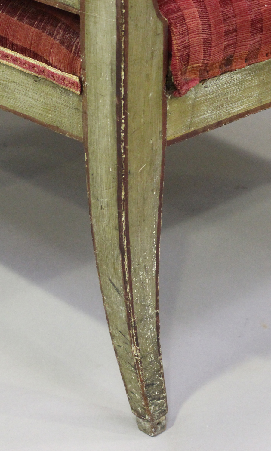 A 19th century Swedish green painted scroll armchair with foliate decoration, upholstered in red - Image 4 of 9