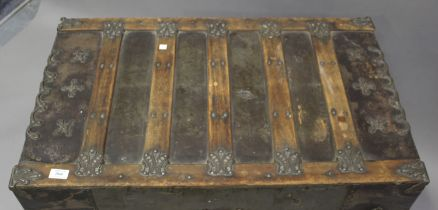 An early/mid-20th century American metal bound travelling trunk, height 65cm, width 87cm, depth