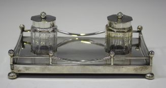 A late Victorian silver inkstand of rectangular form with galleried surround, fitted with two cut