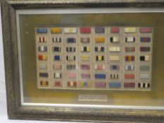 "A display of old medal ribbons ""Ribbons of War medals worn by British soldiers"" in glazed display"