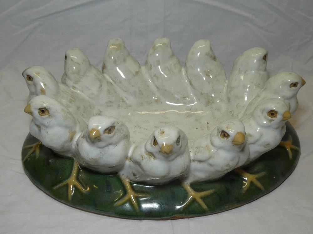 A modern glazed Studio pottery bowl, the rim decorated with twelve birds,