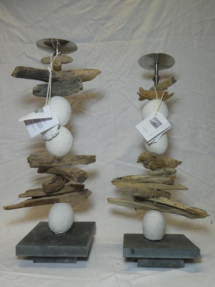 A pair of Cornish natural stone and driftwood candleholders by David Raine of St Ives,