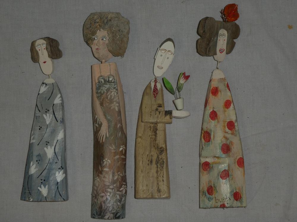 Four Lynn Muir painted driftwood character figures,