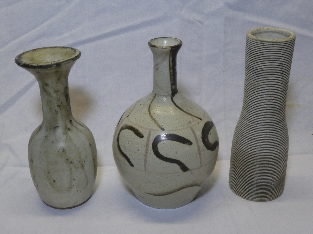 A Studio pottery tapered spill vase with painted decoration,