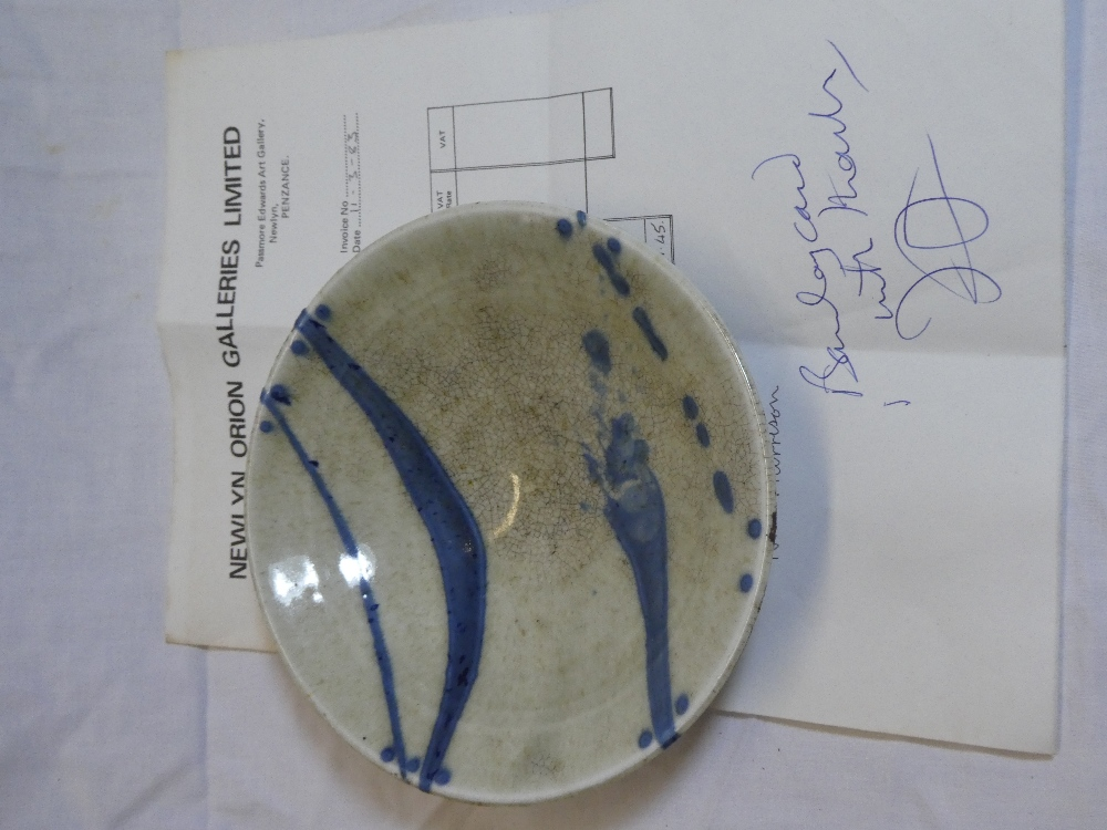A Studio porcelain circular dish by Nic Harrison with original Newlyn Orion Galleries receipt dated