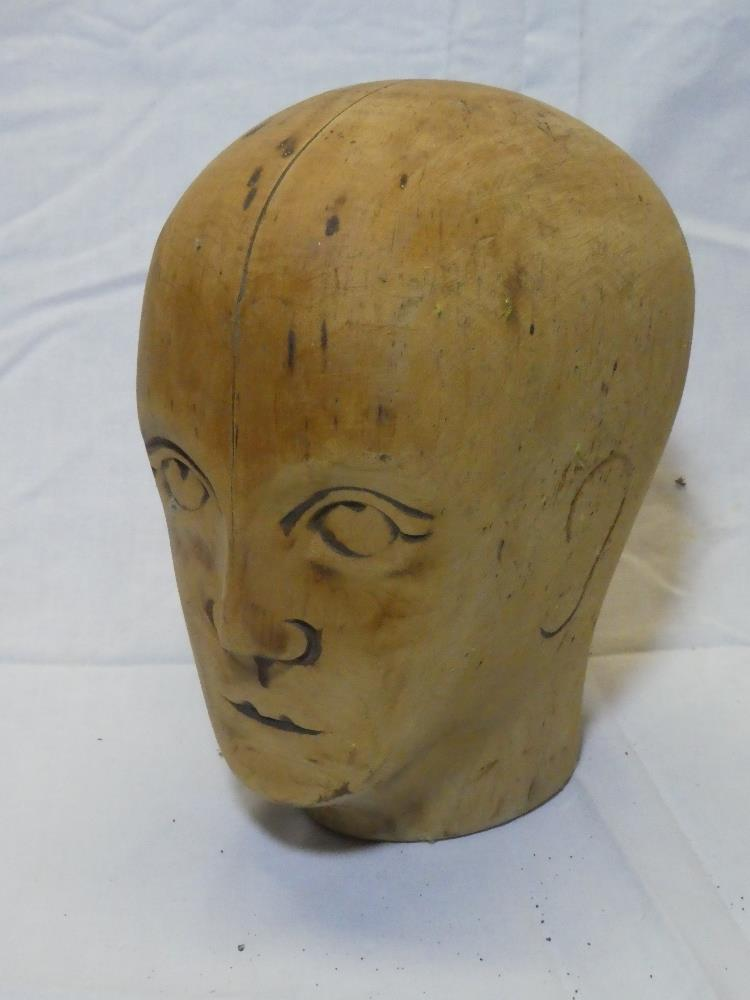 "An unusual rustic wooden sculpture of a male head, signed ""HB"","