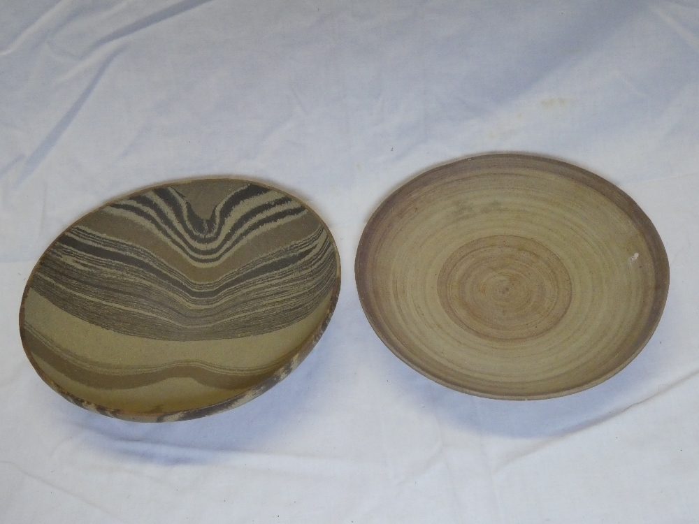 """A Studio pottery circular bowl signed """"MW"""", 8"""" diameter and one other Studio pottery oval bowl,"""