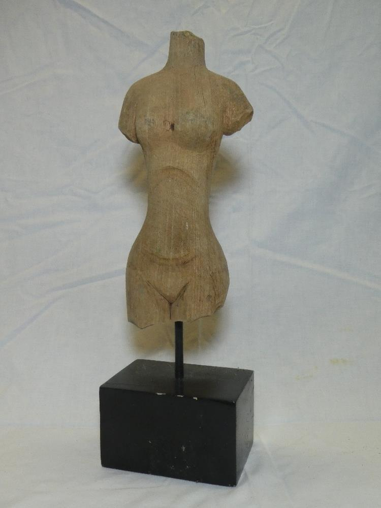 """A wooden sculpture of a female torso 11"""" high on a wooden stand"""