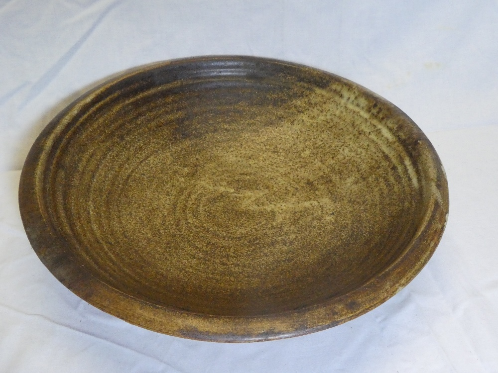 A Studio pottery brown glazed circular bowl by B Picard, Mousehole Pottery,