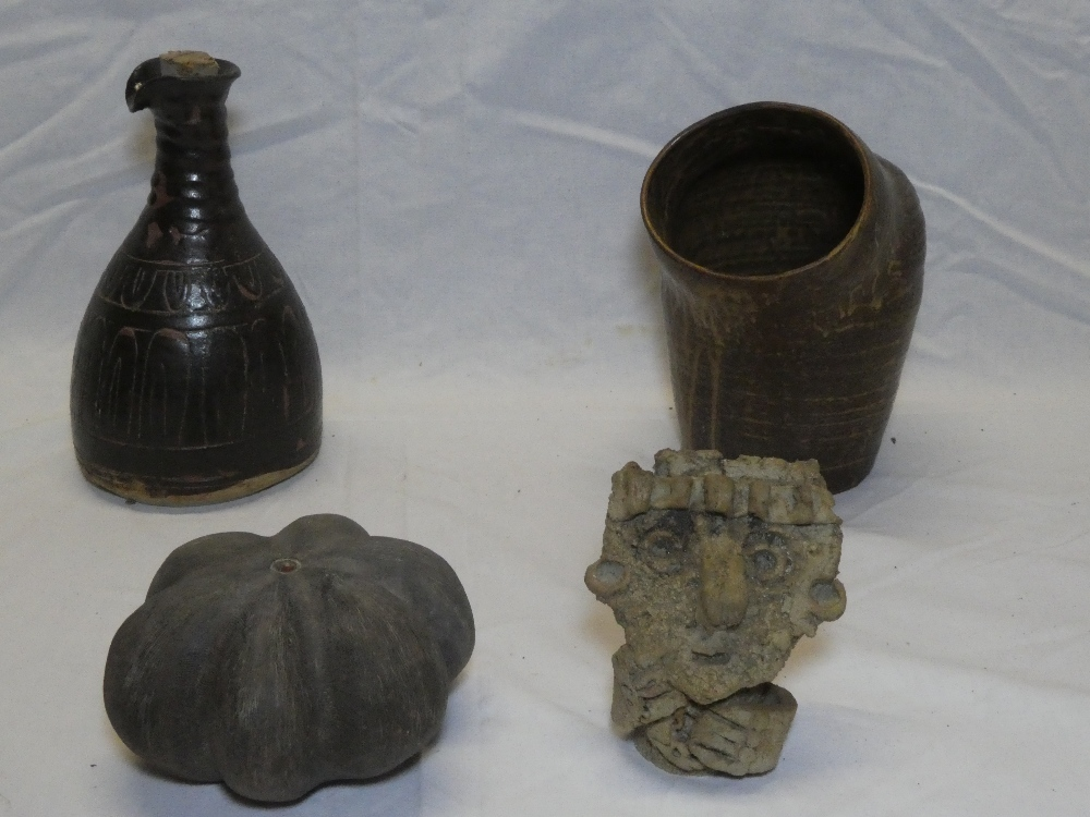 Four pieces of Studio pottery including Lemon Pottery flagon with incised decoration,