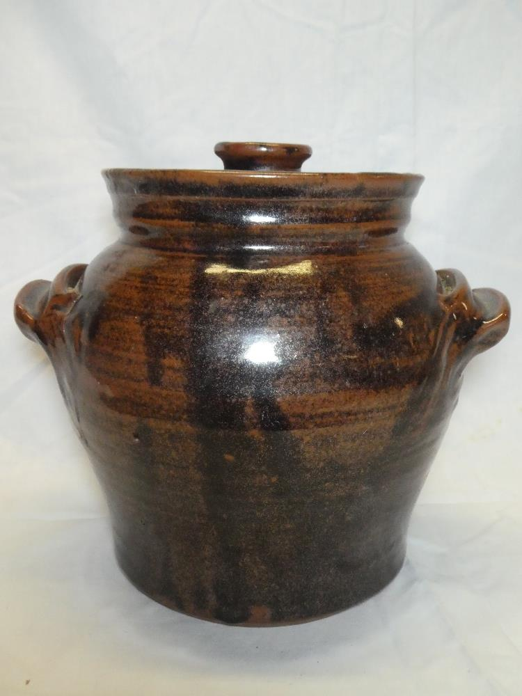 A St Agnes Studio pottery two-handled jar and cover with brown and black glazed decoration,