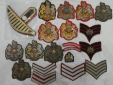 A collection of Guards badges and insignia including numerous RSM embroidered wire and cloth arm