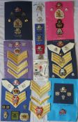 A collection of 17/21 Lancers and Queens Royal Lancers badges and insignia including cap badges,