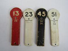 Four traffolyte signal lever identification plates, 13, 23,
