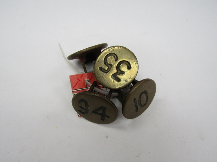 Four brass signal box lever plate numbers, 10, 35,