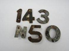 A quantity of cast alloy sleeper identification numbers and letters