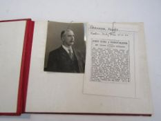 A red bound album to commemorate the retirement of Mr Henry Jackson,