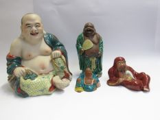 A selection of decorative Oriental figures including Buddha and sage (4), tallest 30cm,