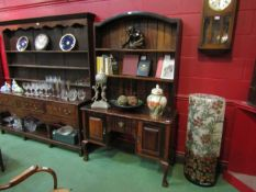 A Queen Anne style hardwood dresser, plate rack above two door, single drawer base,