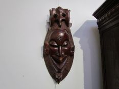 A carved African mask,