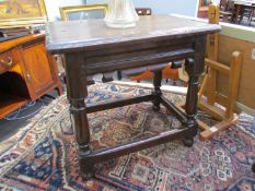 A pair of pegged oak joined stools with chip carved seat over fretwork friezes on turned legs