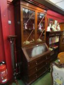 An astragal glazed mahogany bureau bookcase with two short over two long drawers.