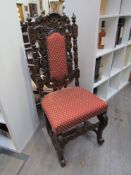 A pair of Victorian carved oak hall chairs with upholstered back & seat