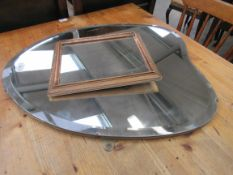 An Art Deco heart shaped wall mirror and a small gilt framed mirror (2)