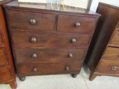 A Victorian mahogany two over three chest of drawers