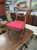 A set of four Victorian mahogany dining chairs,
