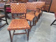 A set of six late Victorian French oak and leather woven dining chairs
