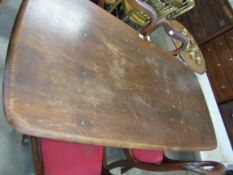 A dark Ercol dining table,