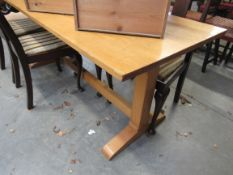 A beech dining table on H form stretcher base,