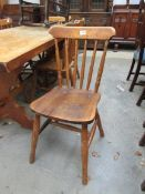 A mixed set of seven pine kitchen chairs