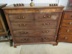 A George III flame mahogany chest of two short over four long drawers on ogee bracket feet,