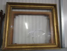 A 19th Century gilt and gesso picture frame with glass and mount,