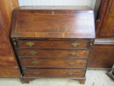 A George III mahogany bureau, fall front over four graduating long drawers,
